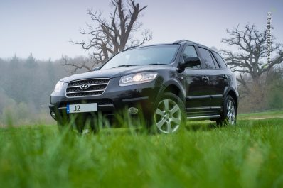 "Shot from ground level, the front three quarter view of the 2006 mkII Santa Fe helped by arch-filling 18"" alloy wheels"