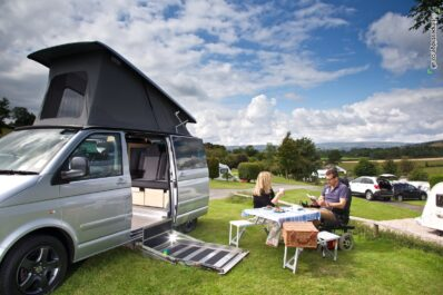 Above: Disabled camper van set up on campsite